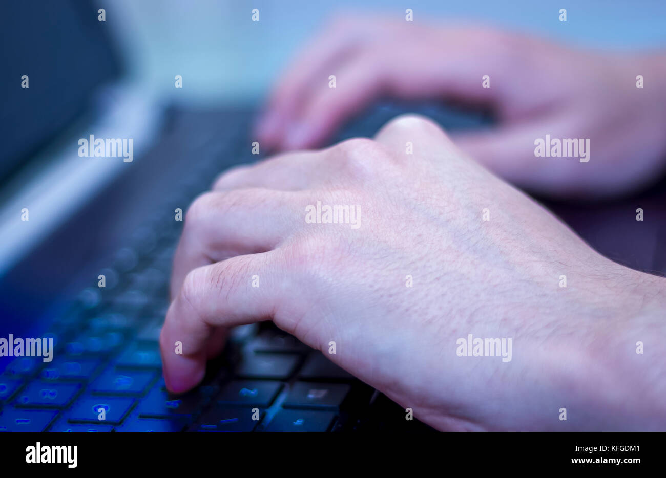 mans hands typing on keyboard - Stock Image