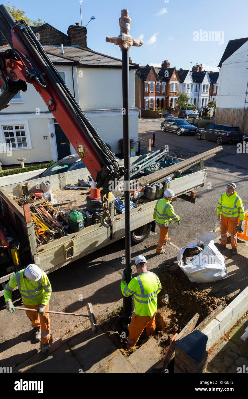 ornate lighting. Team Of Lighting Contractors Fitting A Heritage Street Lamp / Lamppost Cast Ornate