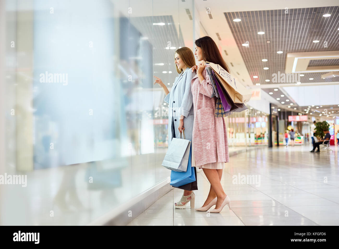 Two Girls Window Shopping in Mall - Stock Image
