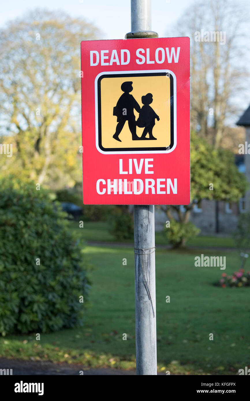 Beware Dead Slow Live Children Playing Sign - Stock Image