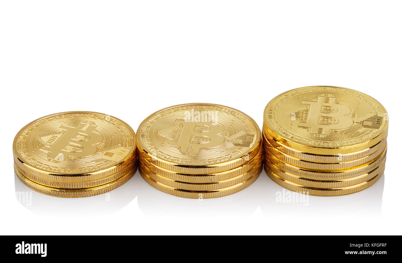 Three rising stacks of virtual bitcoins - Stock Image