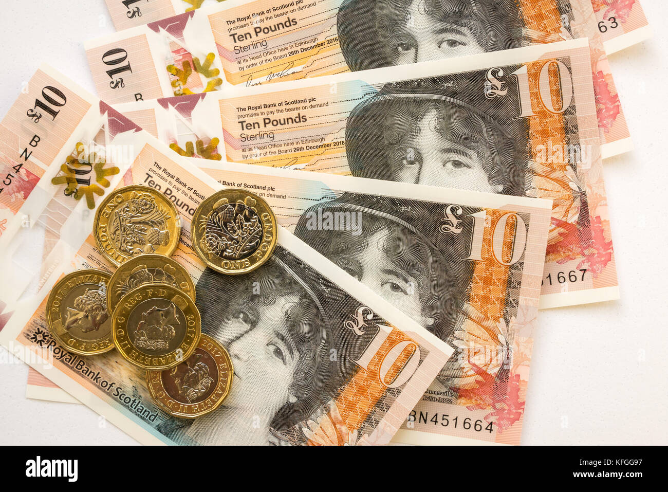 Close up of Royal Bank of Scotland new plastic polymer ten pounds £10 banknote and new hexagonal one pound £1 coins Stock Photo