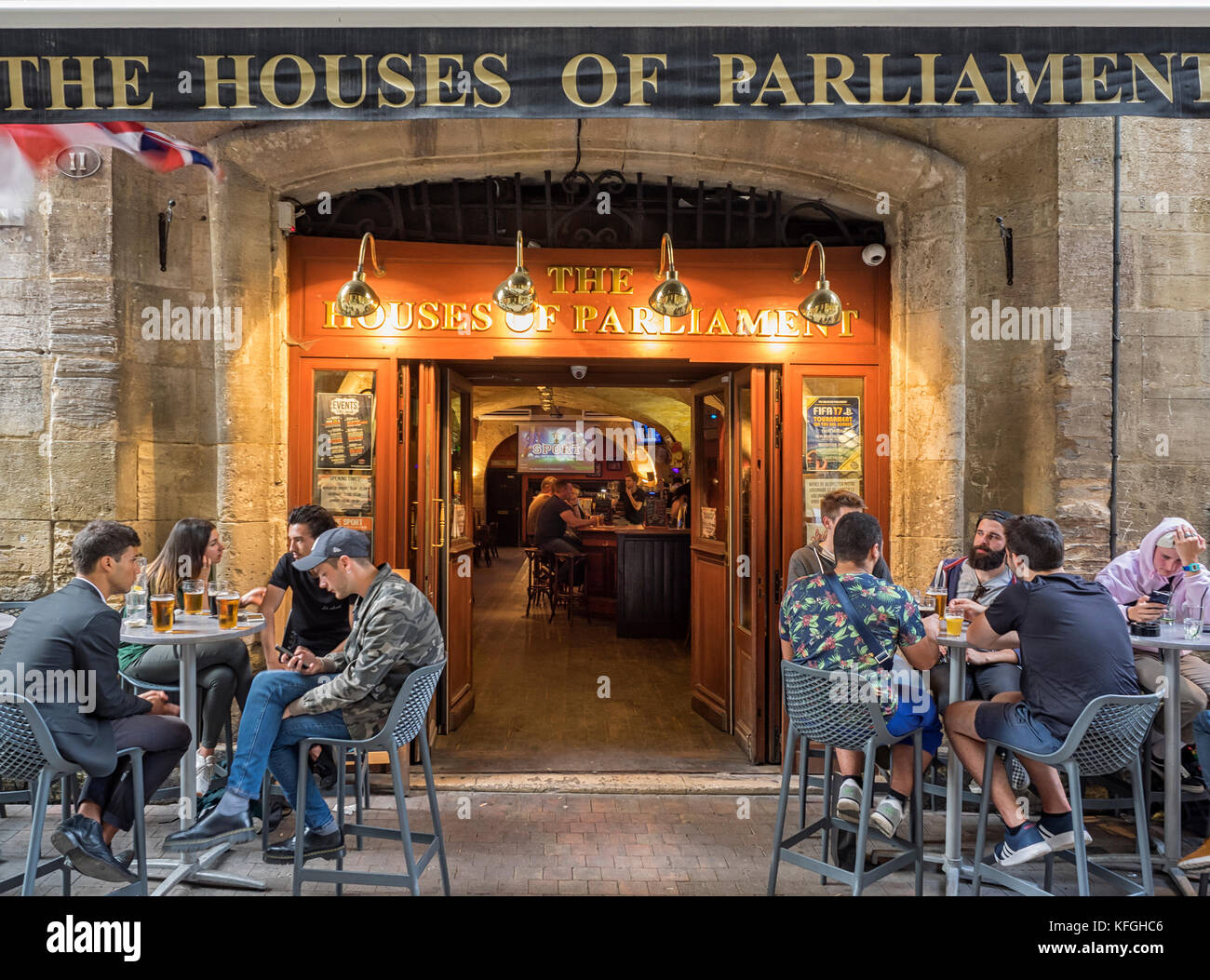 PLACE DU PARLEMENT, BORDEAUX:  People sitting outside Cafe Bar in this pretty Square Stock Photo