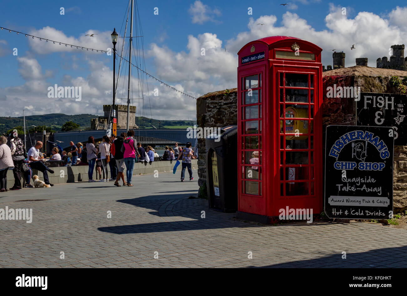 Red Telephone box or kiosk in Conwy North Wales now containing a defibrillator - Stock Image