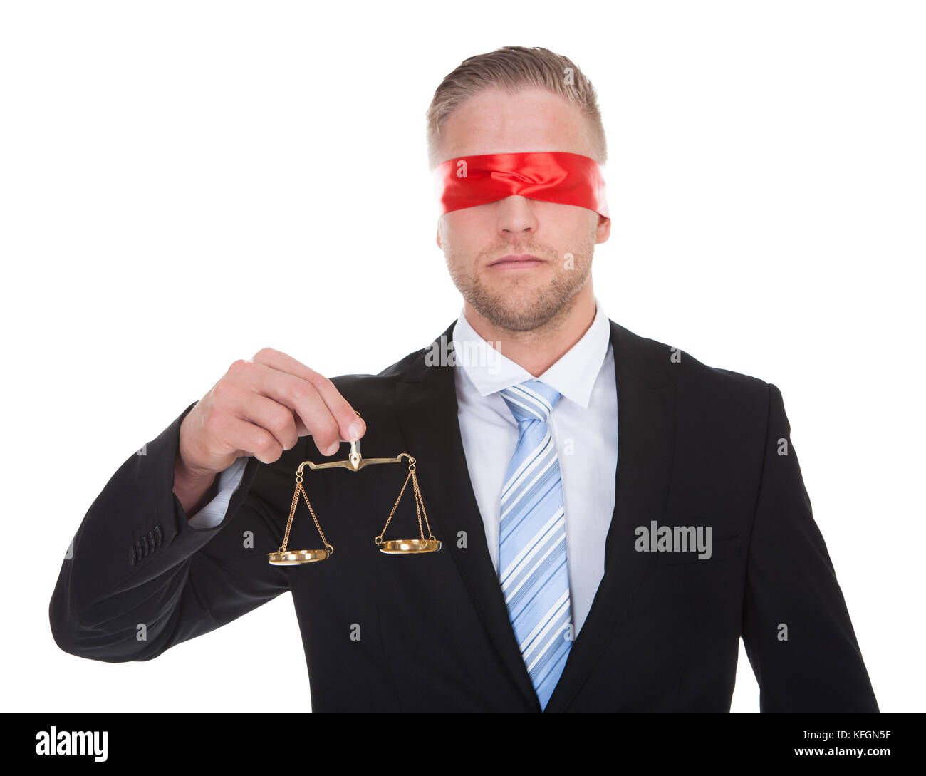 Lawyer or judge with the scales of justice in his hand wearing a blindfold  conceptual of impartiality and fairness - Stock Image