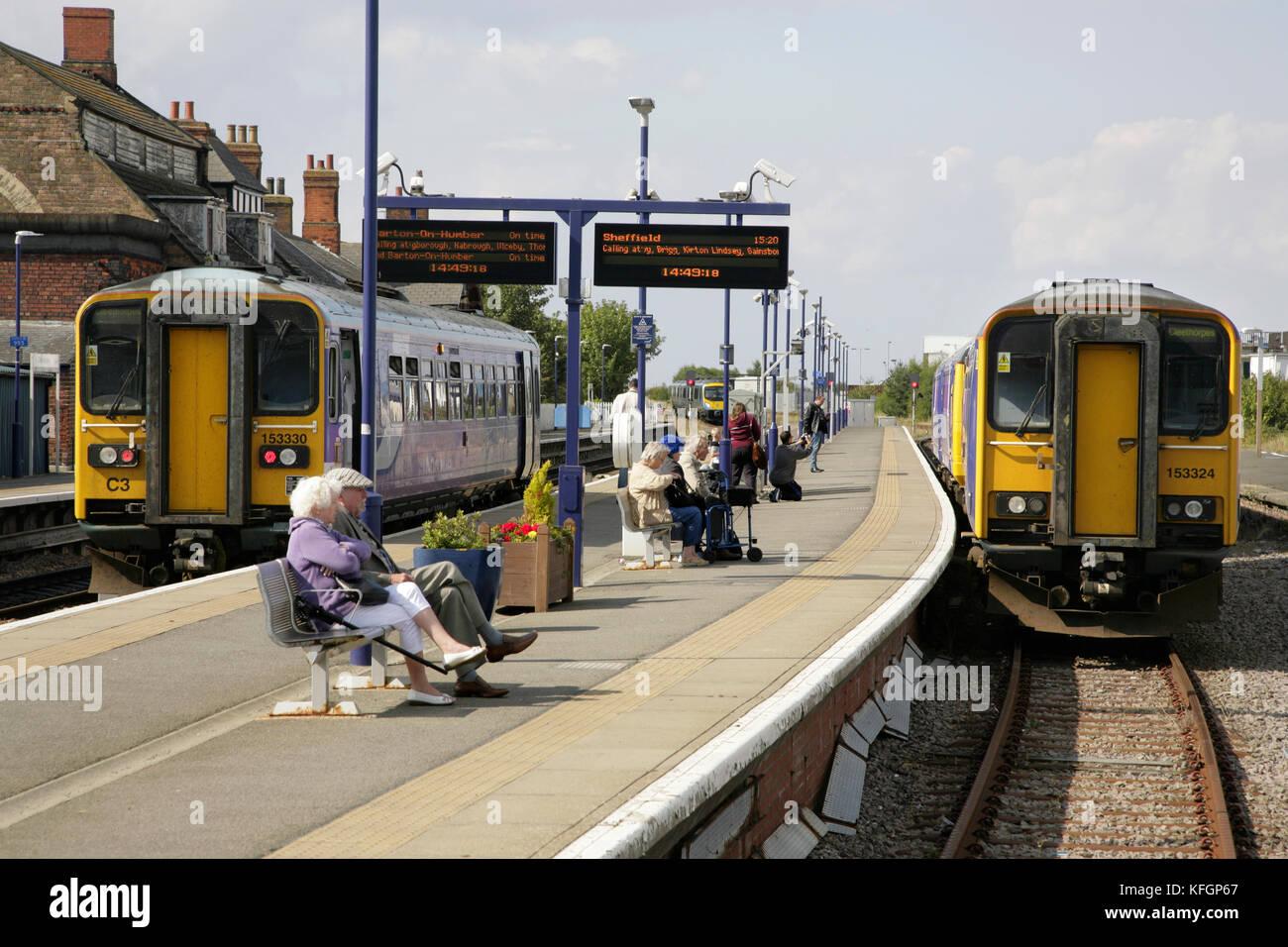 Trains and passengers at Cleethorpes station, UK. - Stock Image