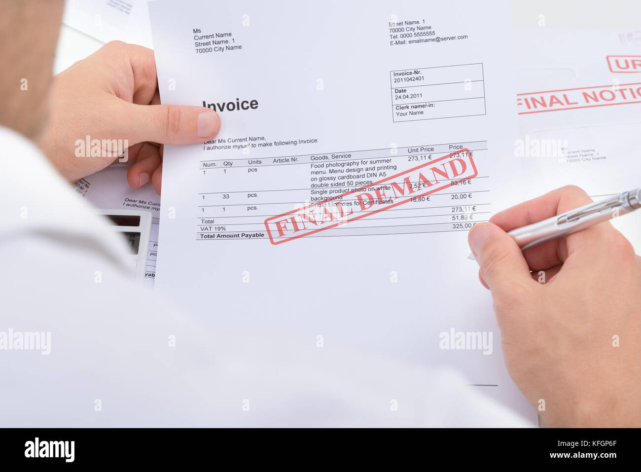 Close-up Of A Man Holding Invoice With Final Demand Notification And Pen - Stock Image