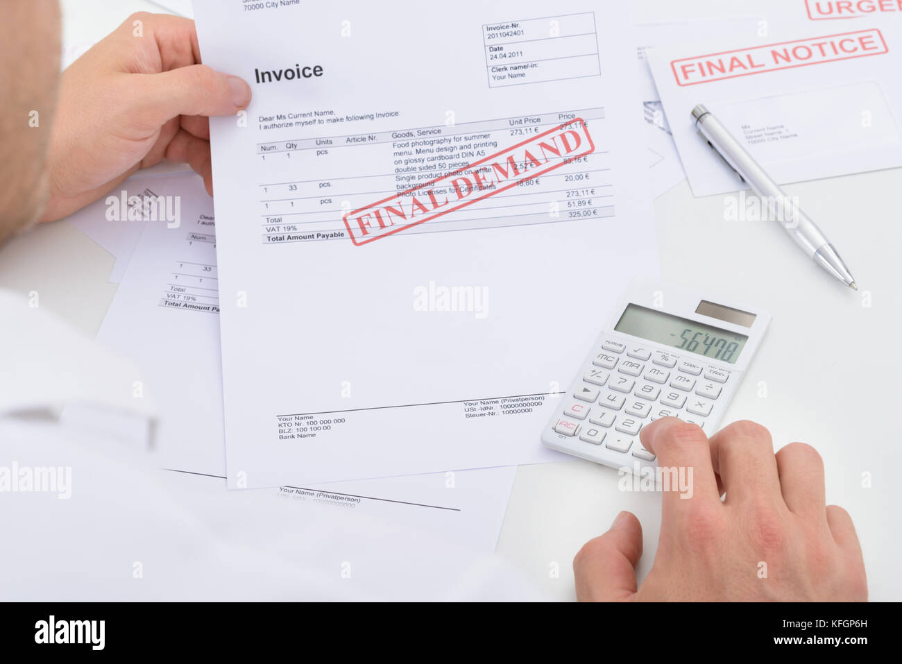 Man Calculating Invoice With Final Demand Notification - Stock Image