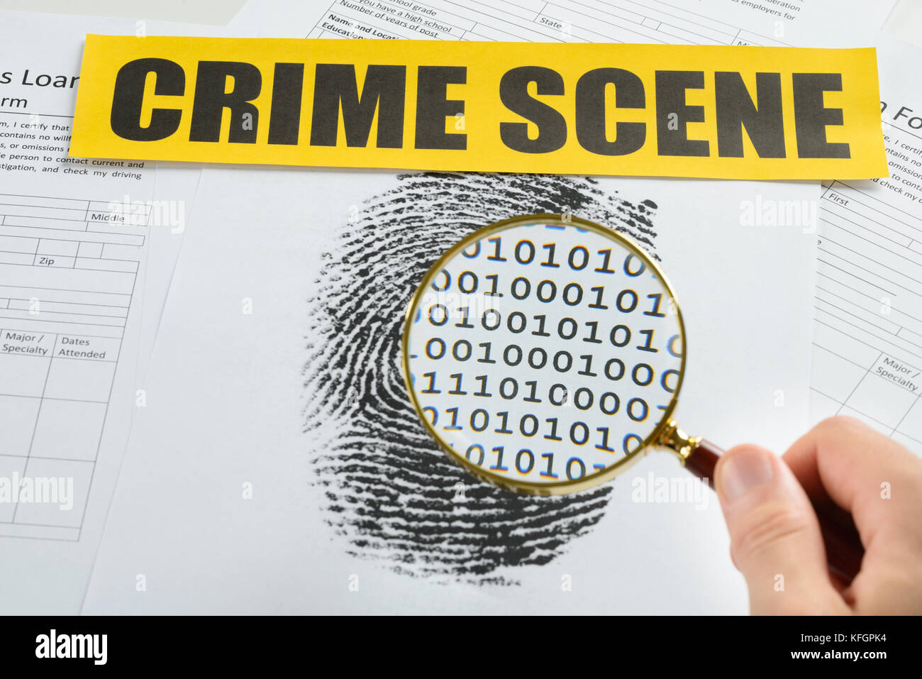 Person Hand With Magnifying Glass Over Document Revealing Binary Code And Crime Scene Tape On It - Stock Image