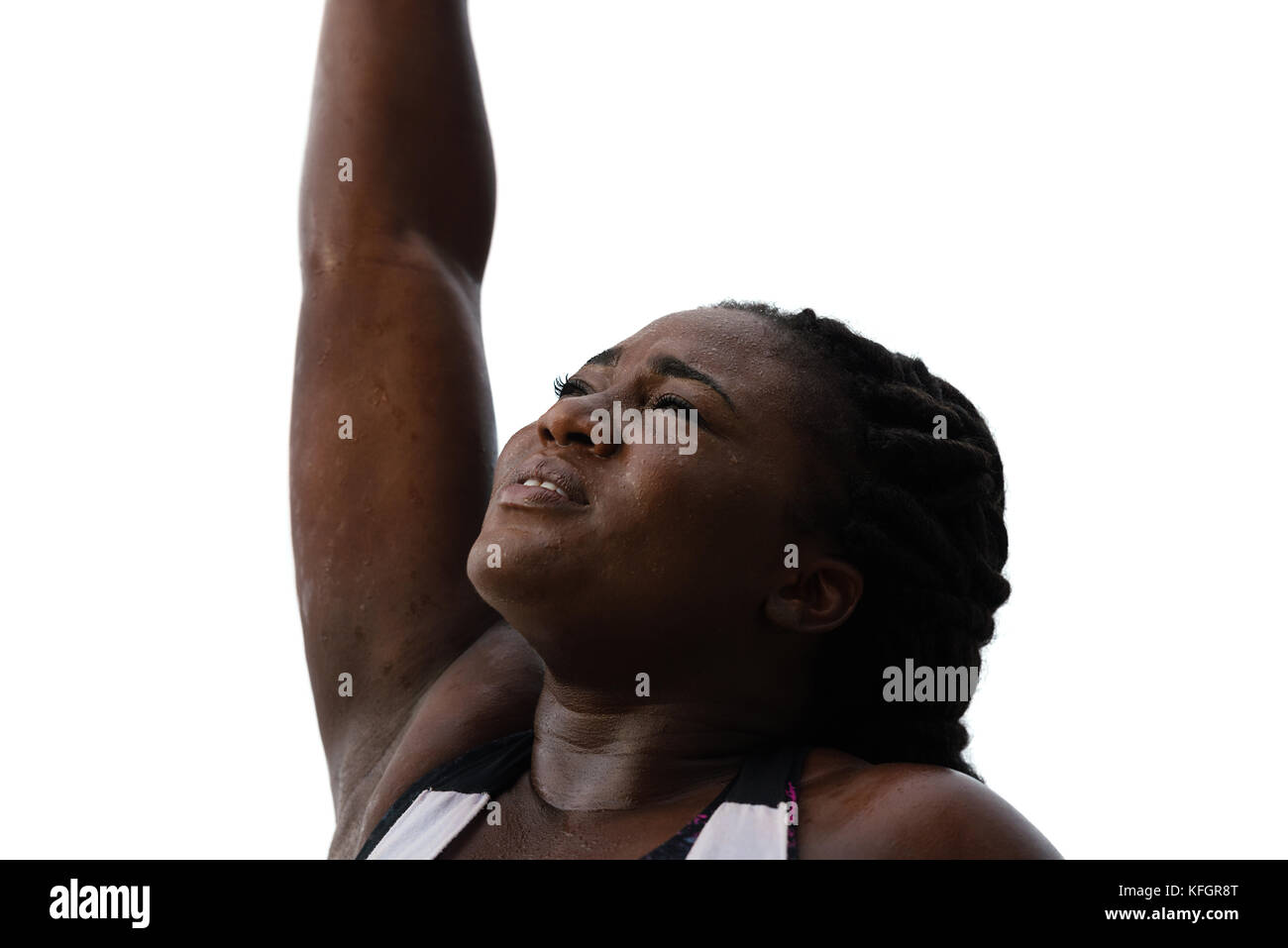 sporty african woman  sweating after exercising under rain,isolated over white  background.Female athlete after - Stock Image