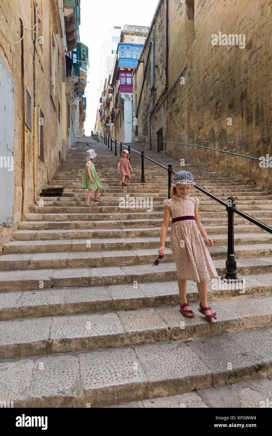 Girls / children / kids / child / kid walking up and down stairs steps / long stairway stair way on: Mikiel Anton Stock Photo