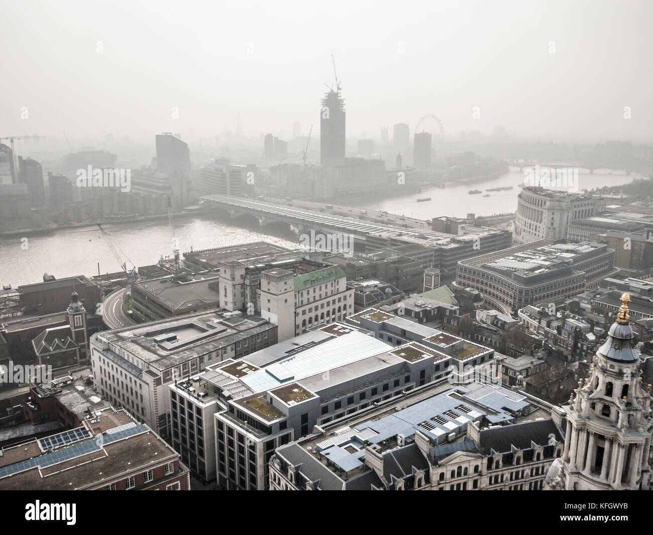 View from St Pauls Cathedral showing heavy air pollution and smog over London - Stock Image