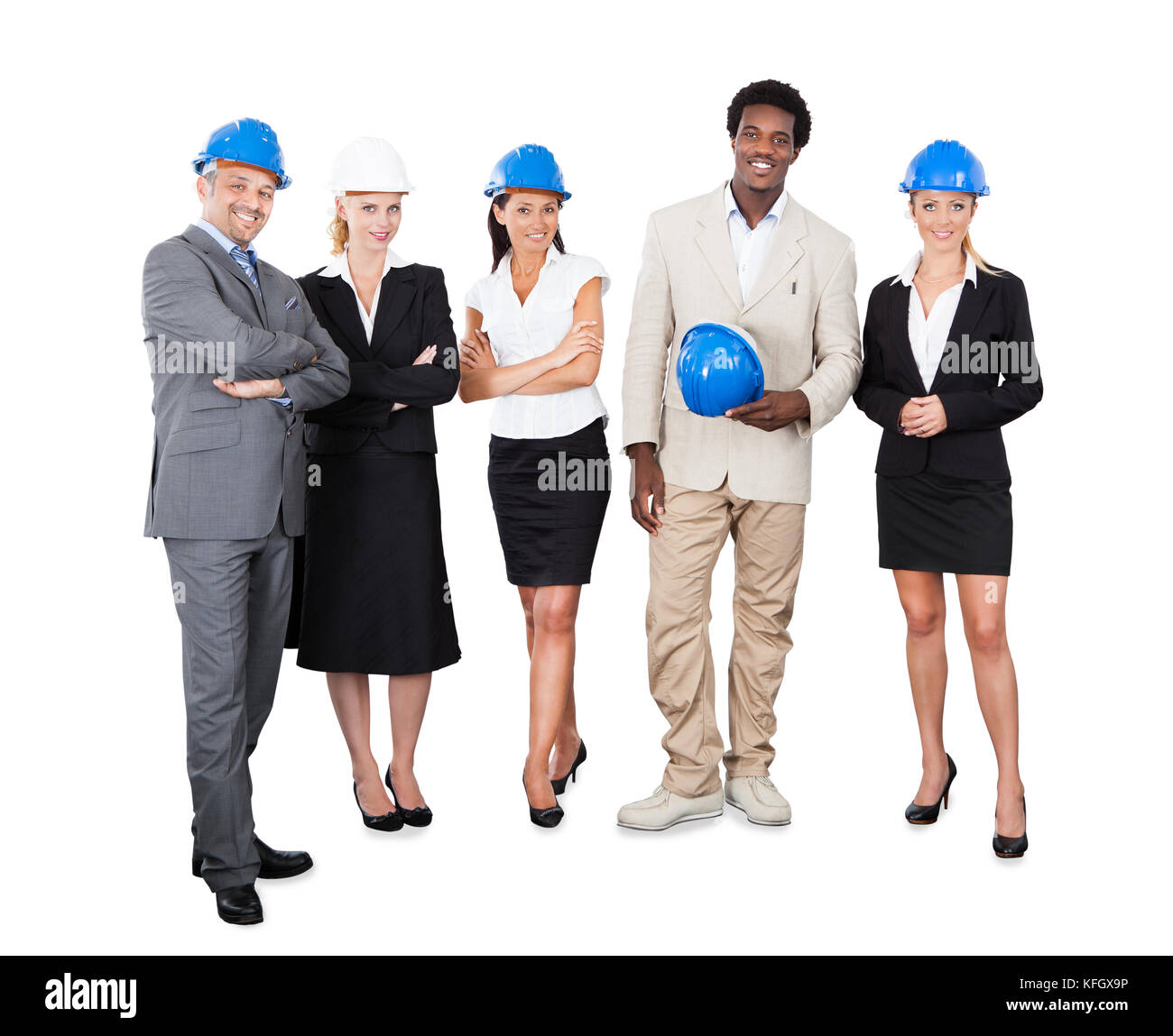 Full length portrait of multiethnic architects with hardhats standing against white background Stock Photo