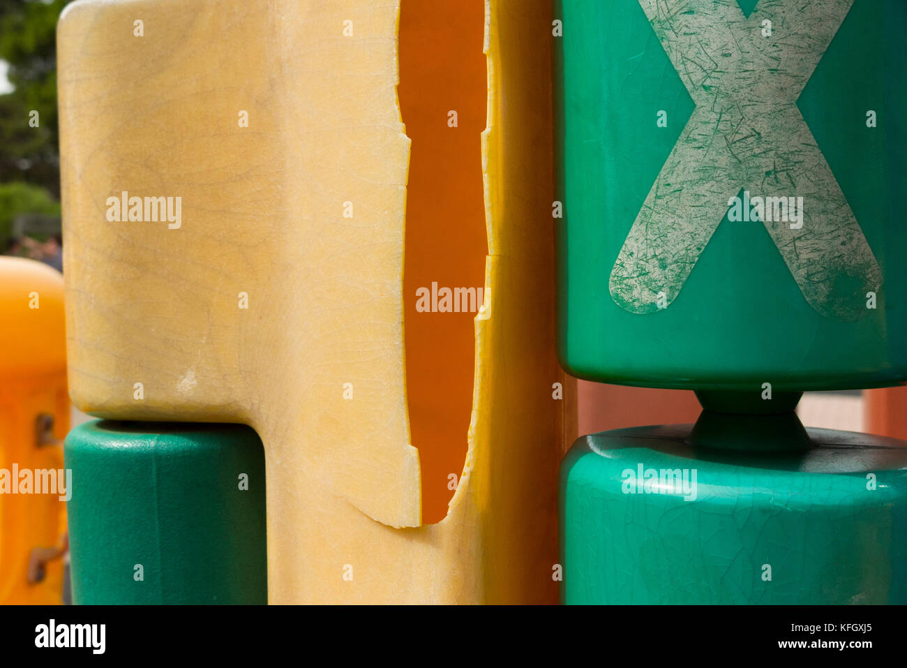 Dangerous play equipment for children playing in the kids park. The edges are sharp and pointed, possibly damaged - Stock Image