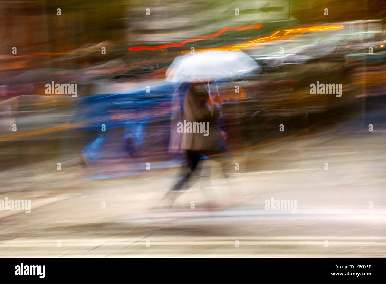 WA14186-00...WASHINGTON - Pedestrian with umbrella on a wet day in down town Seattle. (No MR) - Stock Image