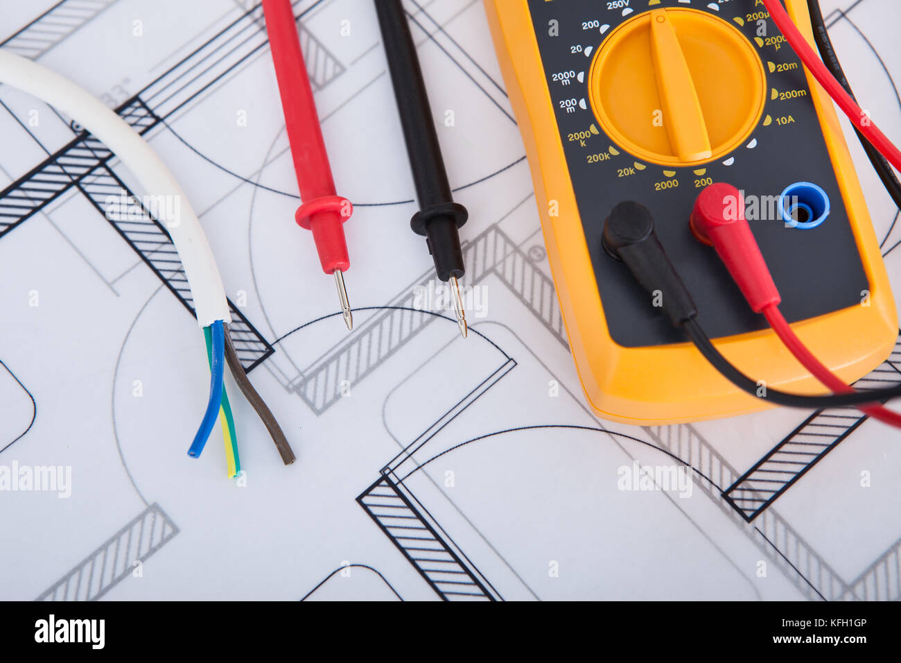 Closeup of multimeter with wires on blueprint - Stock Image