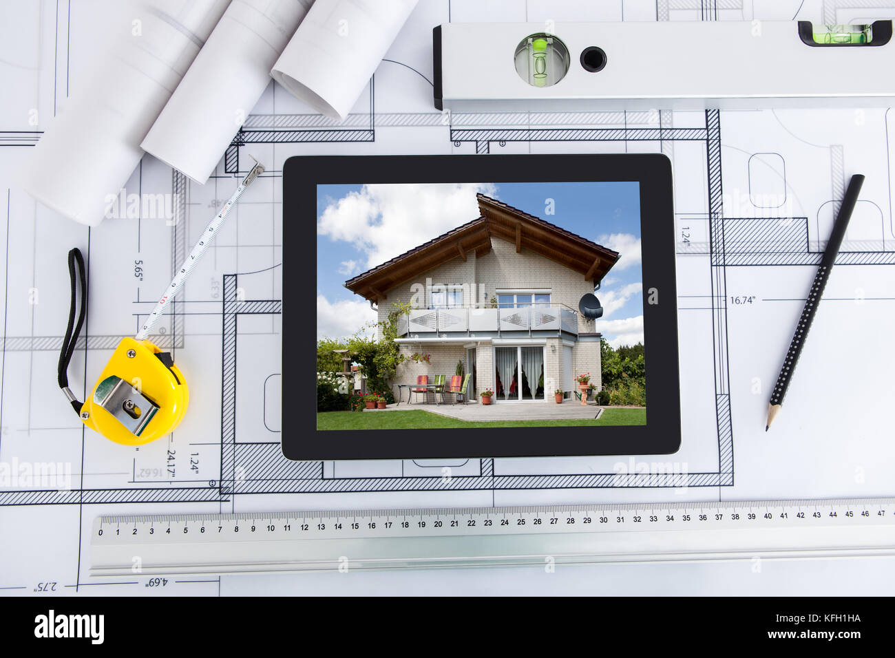 House displayed on digital tablet screen with architects tools over house displayed on digital tablet screen with architects tools over blueprint malvernweather Gallery