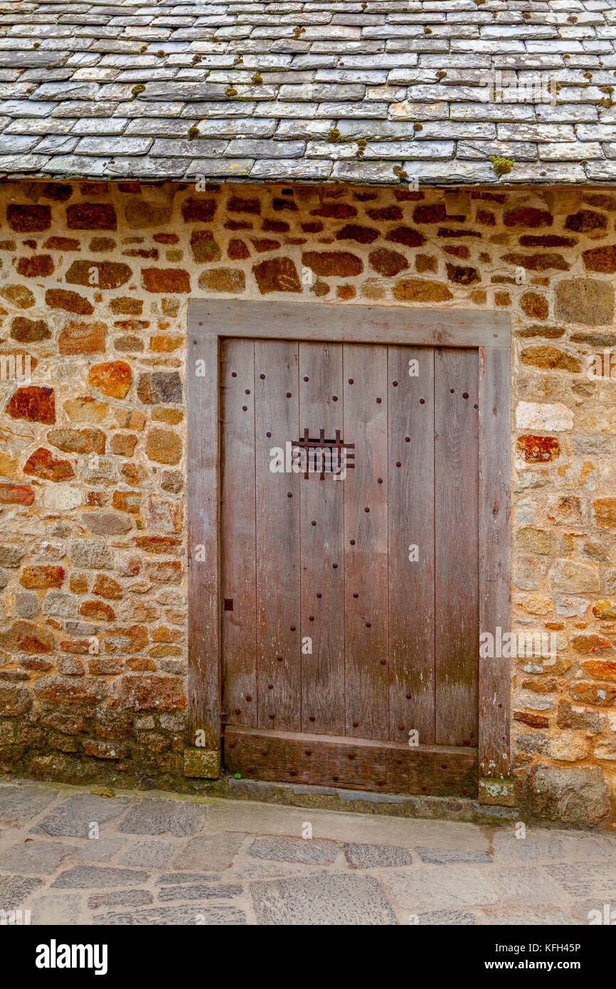 old stone doorway with wooden door on Mont Saint-Michel Normandy France - Stock Image
