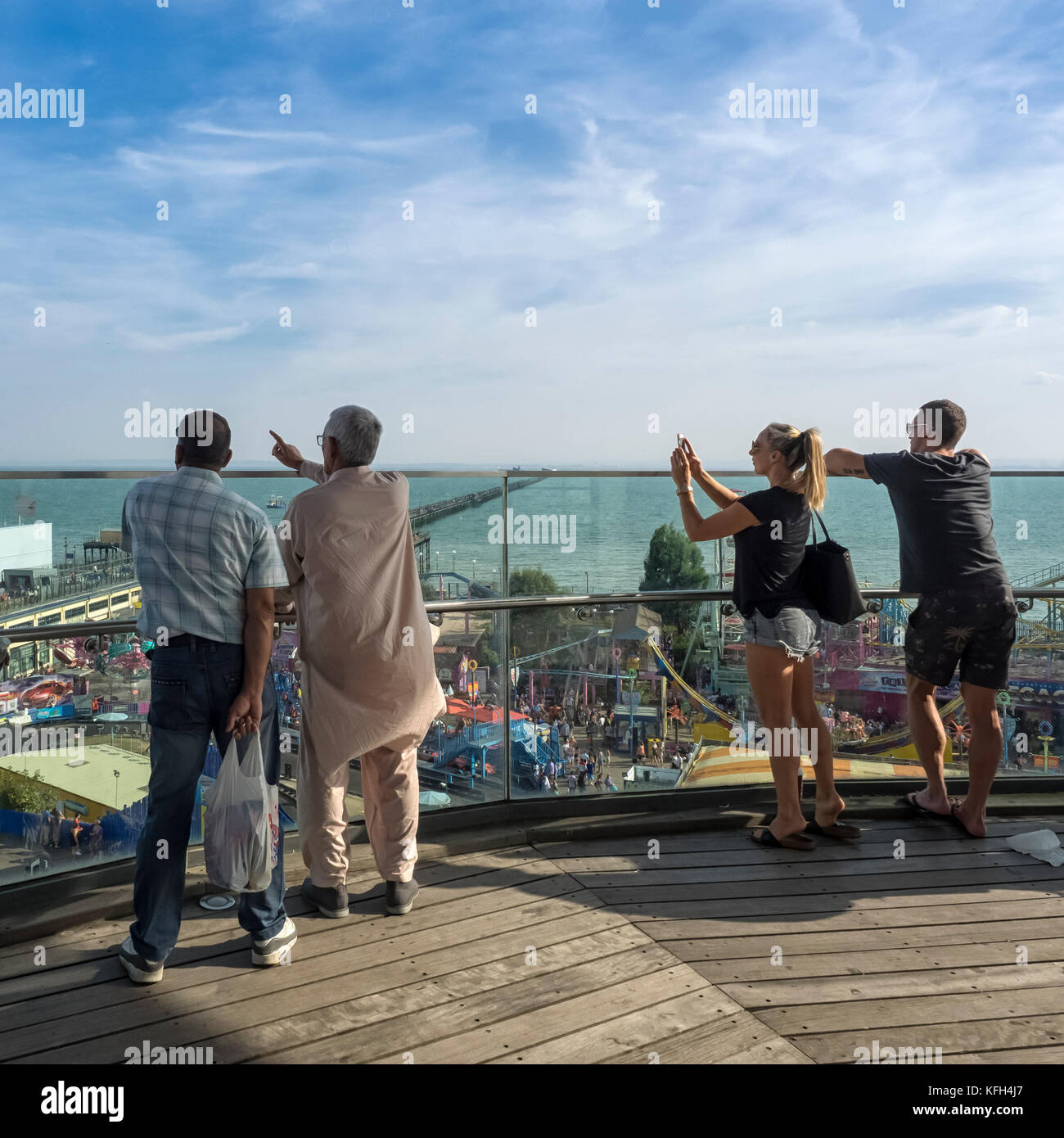 SOUTHEND-ON-SEA, ESSEX:  Visitors on the Seafront Observation Tower looking along the Seafront with the Pier in Stock Photo