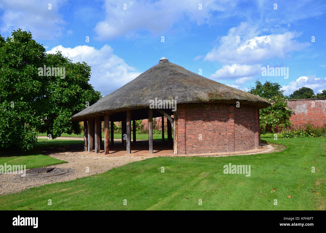 Shelter in the formal garden at Stoneleigh Abbey, Stoneleigh, Warwickshire, UK - Stock Image