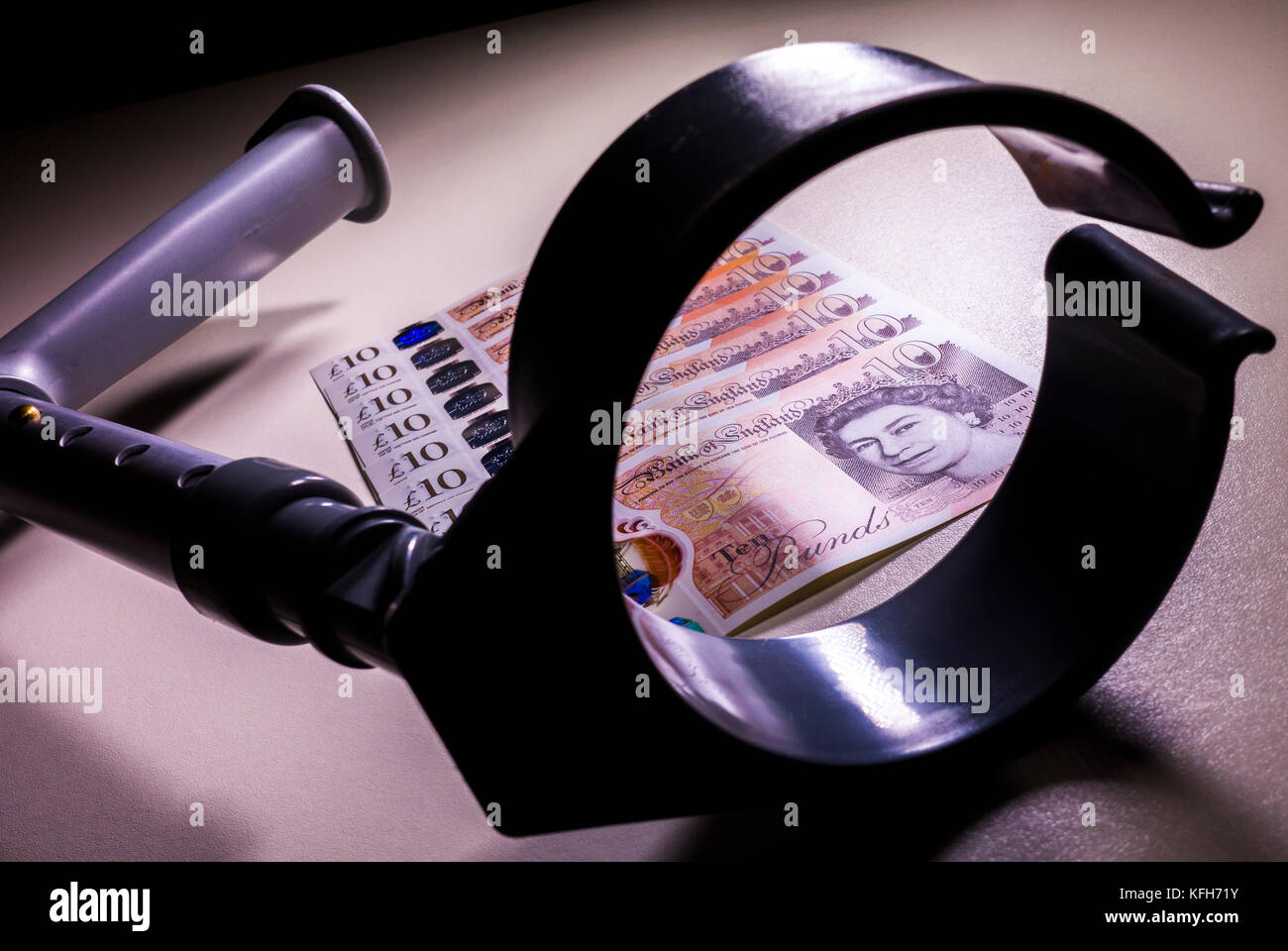 Crutch and new polymer sterling £10 ten pound notes. Concept of link between incapacity and UK pounds, such - Stock Image