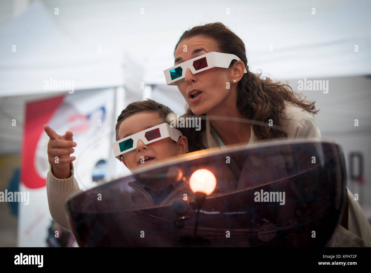 Some people with 3-dimensional glasses - Stock Image