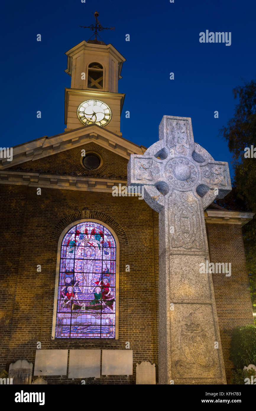 St George's Deal church with celtic cross and illuminated stained glass window at night, Deal, Kent, England, - Stock Image