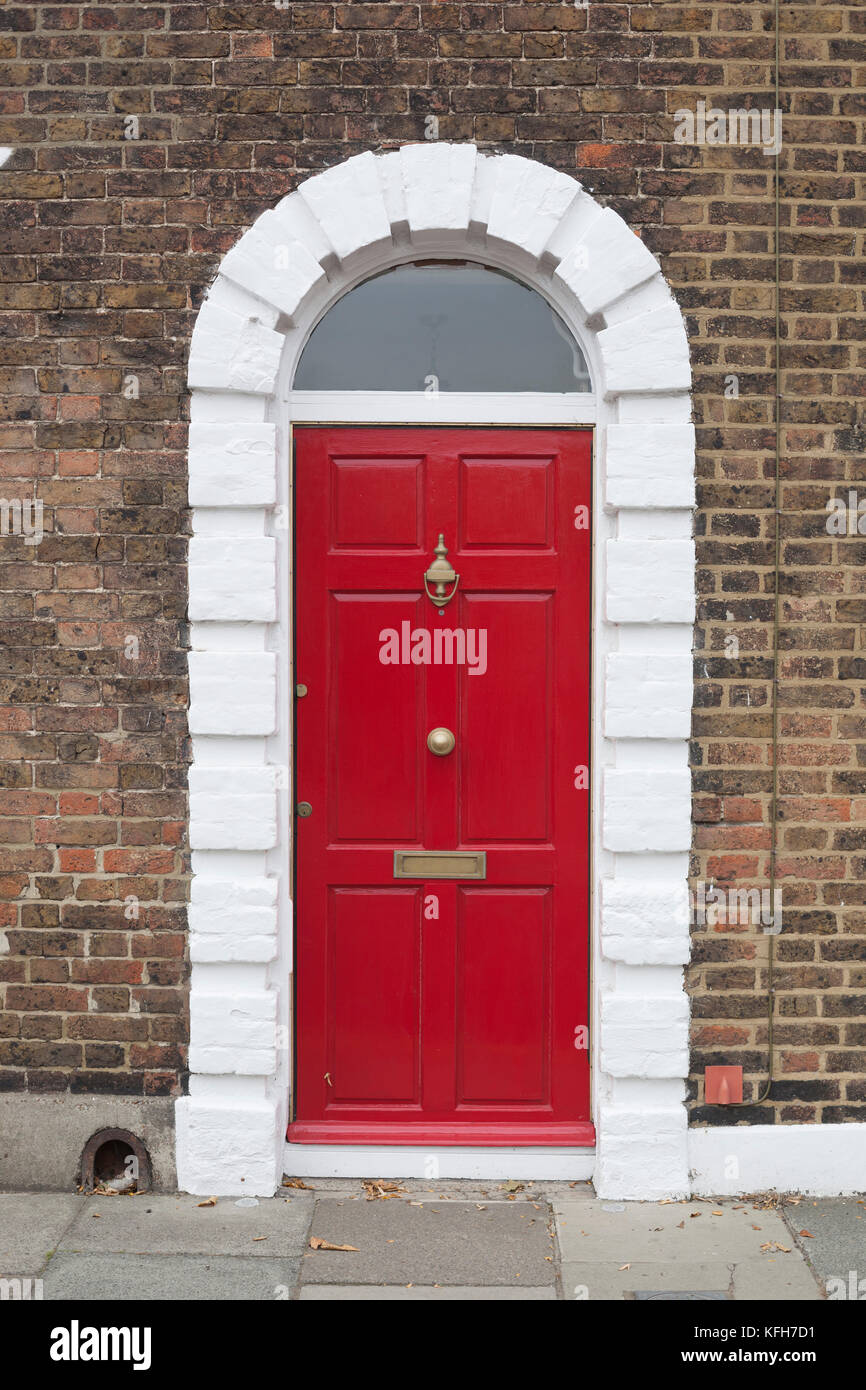 Red Front Door With Gold Letterbox And Knocker And Painted White
