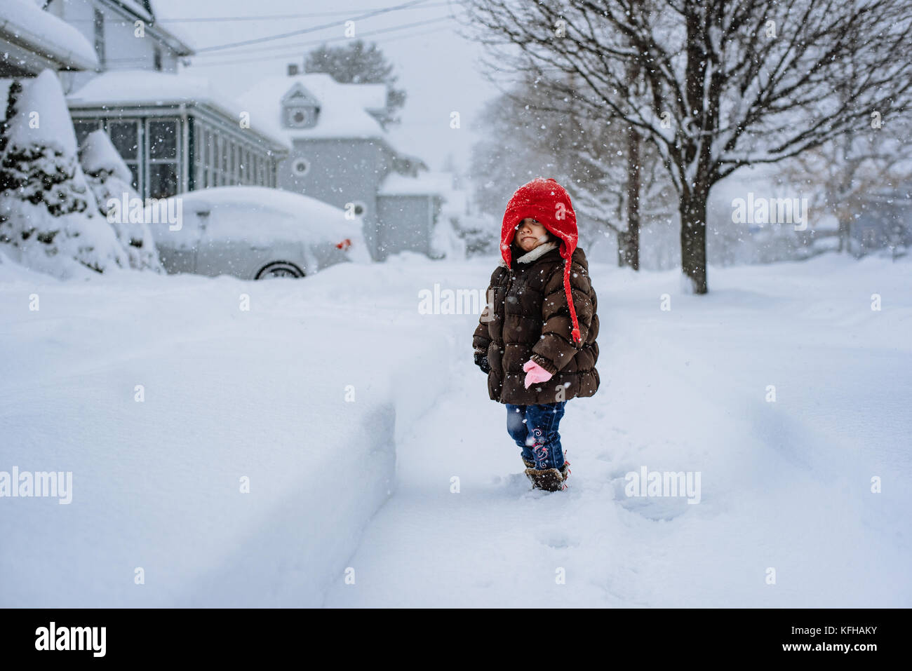 2-3 year old standing in snow - Stock Image