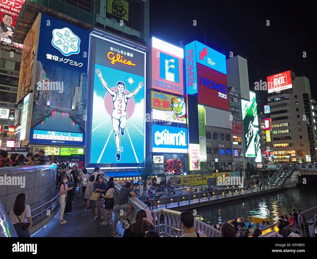View of the bright lights and illuminated signboards in Dotonbori in Osaka Japan - Stock Image