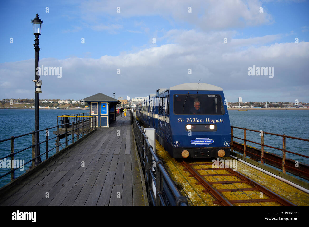 Southend Pier railway train with driver and walkway shelter. Lamp. Space for copy - Stock Image
