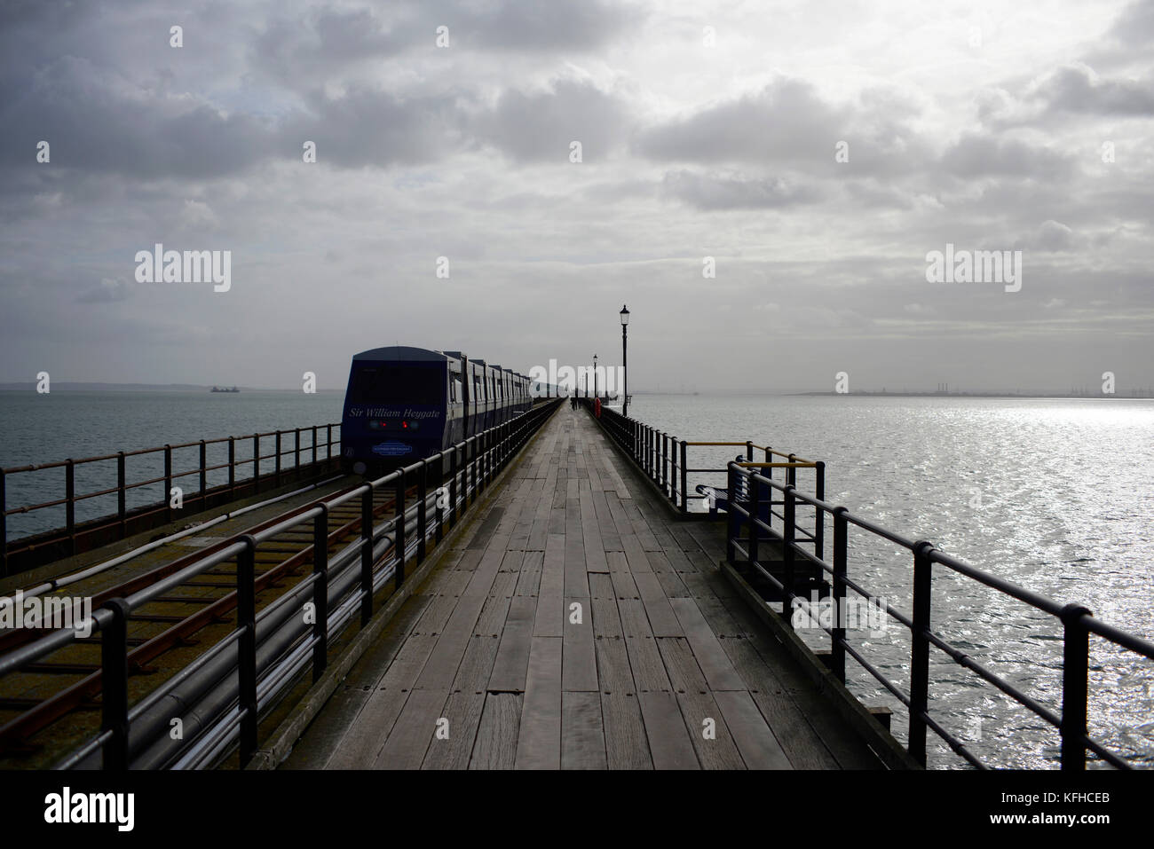 Southend Pier railway heading towards the Thames Estuary. Wide view. Space for copy - Stock Image