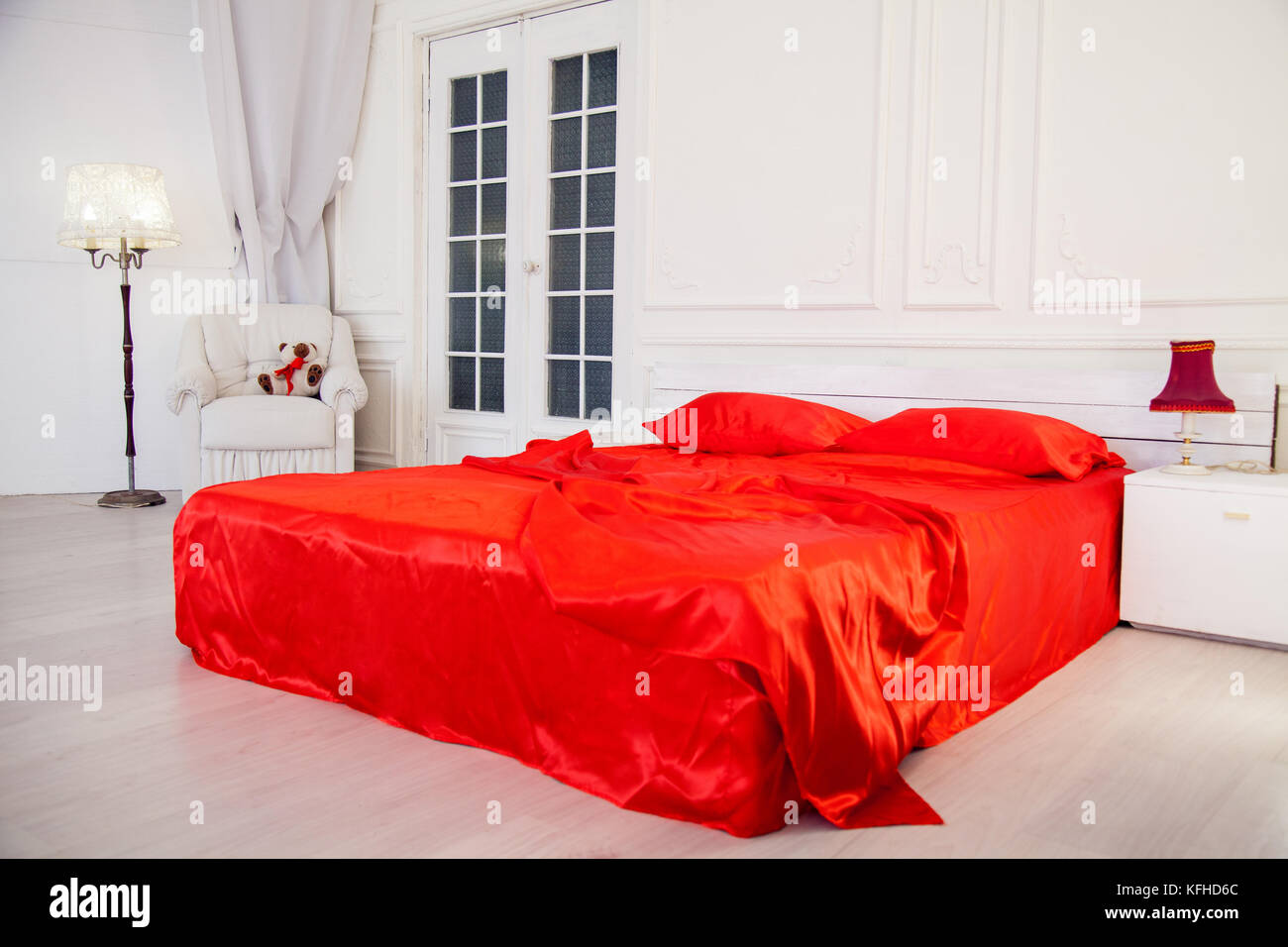 Bed With Red Sheets In White Bedroom Interior   Stock Image