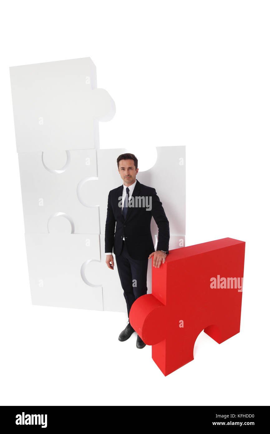 Business and final piece of puzzle isolated on white - Stock Image