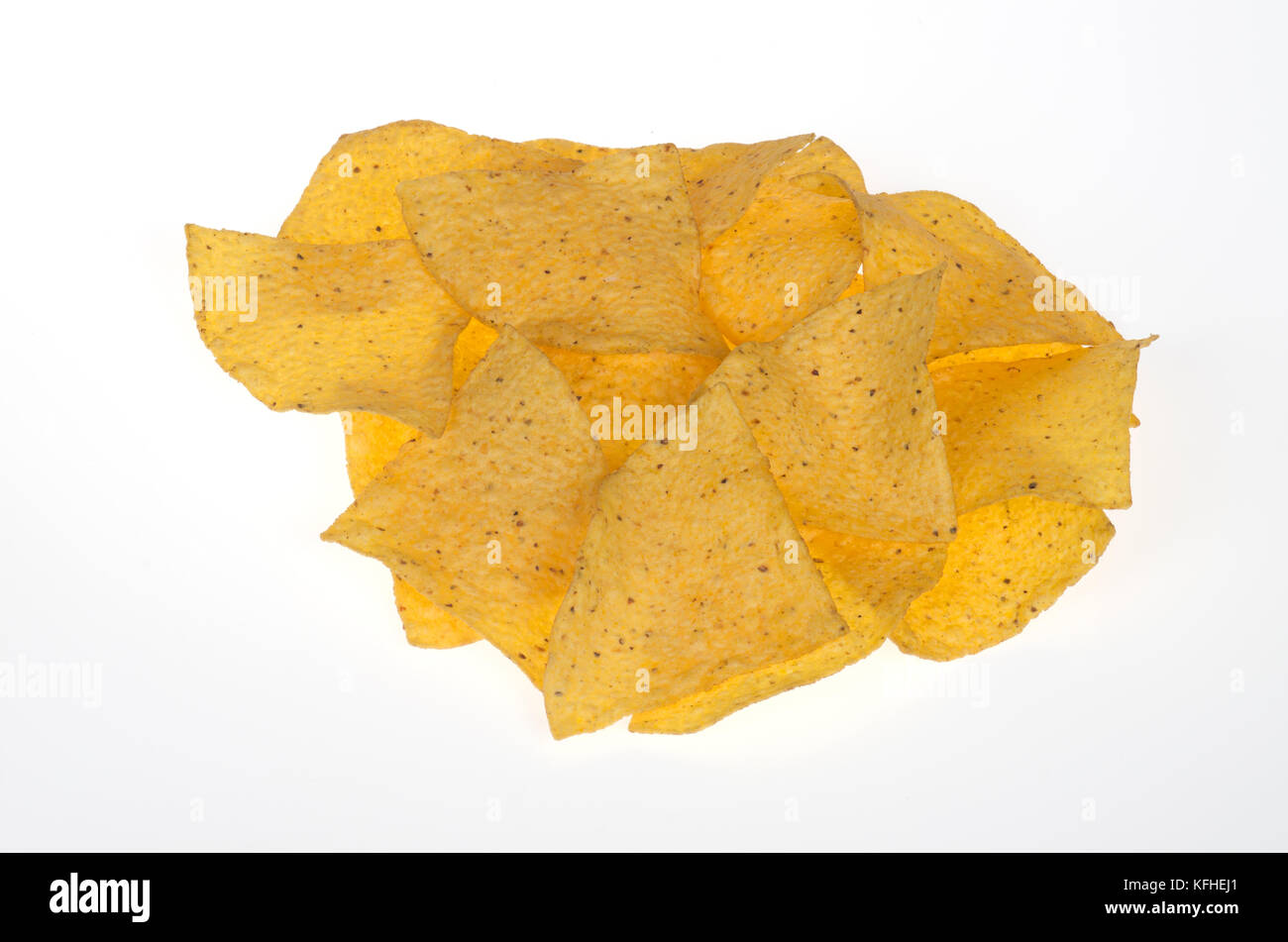 Organic yellow corn chips isolated on white background - Stock Image