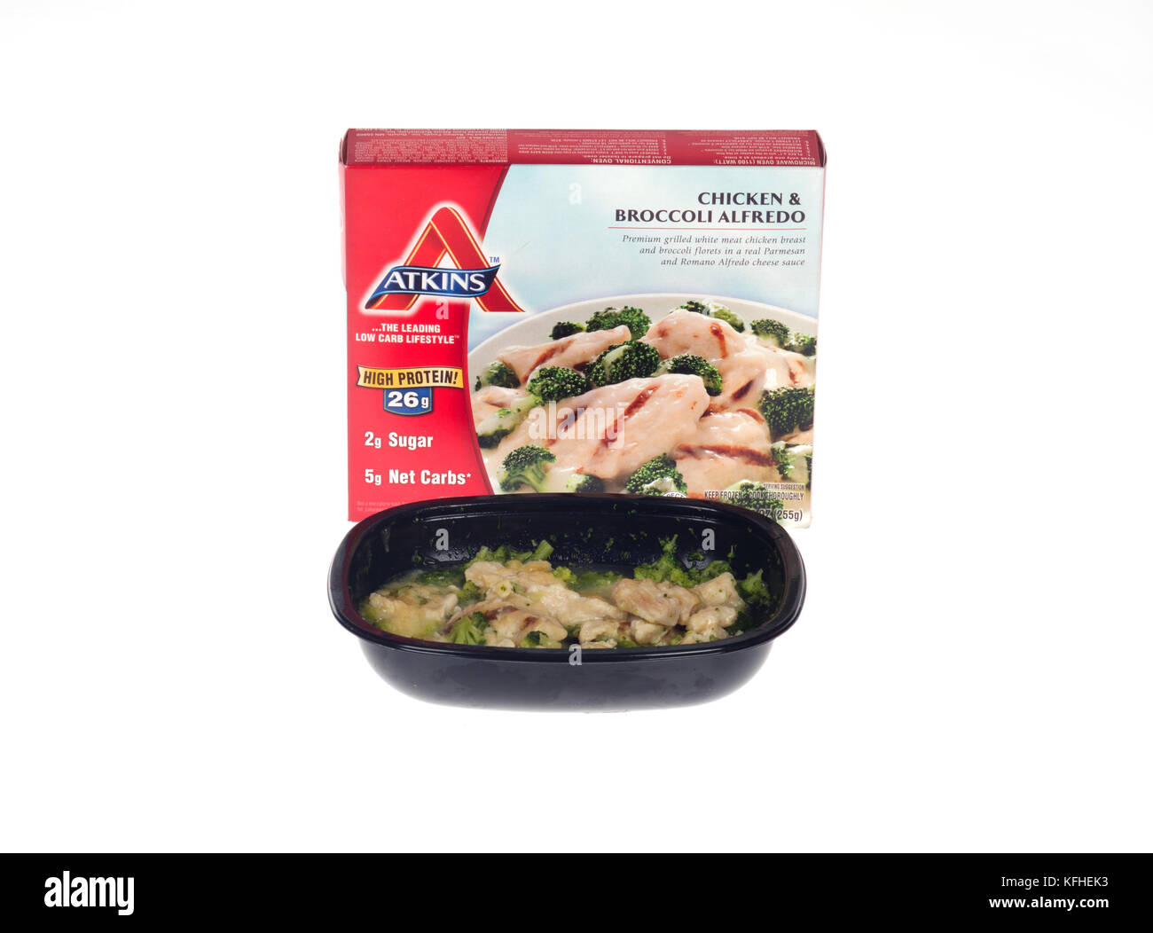 Microwaved Atkins Diet meal of chicken & broccoli alfredo with box and cooked  food tray - Stock Image