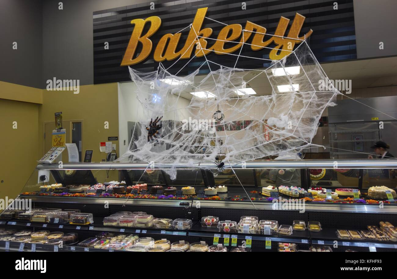 Bakery Counter in Save On Foods Grocery Store in Canmore Alberta with Spider Web Halloween Decoration - Stock Image