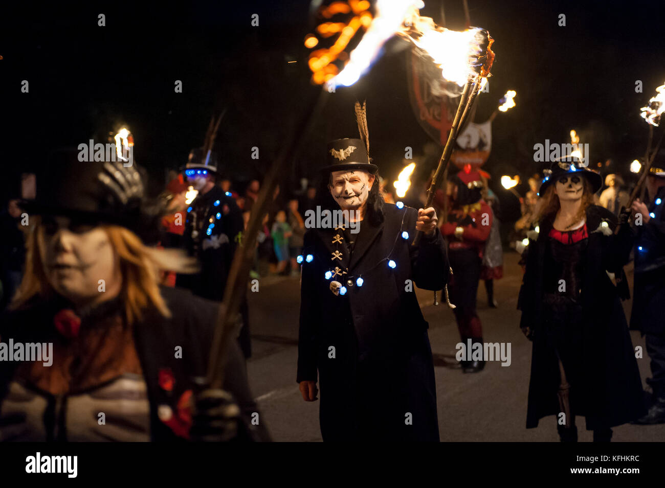 Bonfire Night Celebrations In West Sussex. Dressed in elaborate costumes and holding flaming torches members of Stock Photo