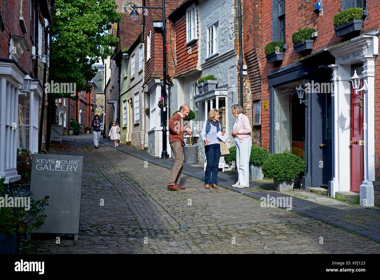 Conversation on cobbled Lombard Street in Petworth, a small town in West Sussex, England UK - Stock Image