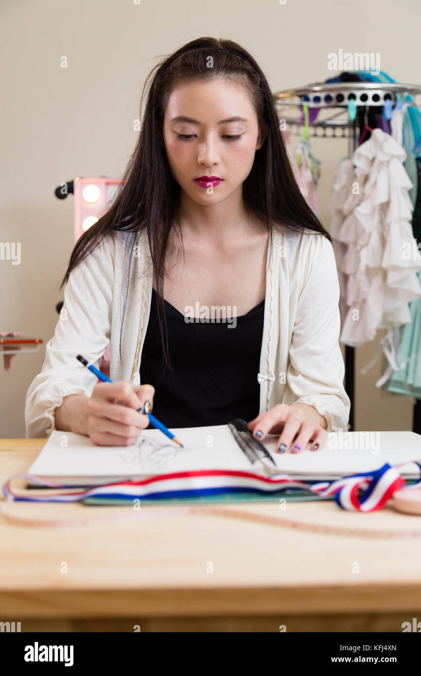 Young Asian American Fashion Designer Sketching Design Stock Photo Alamy