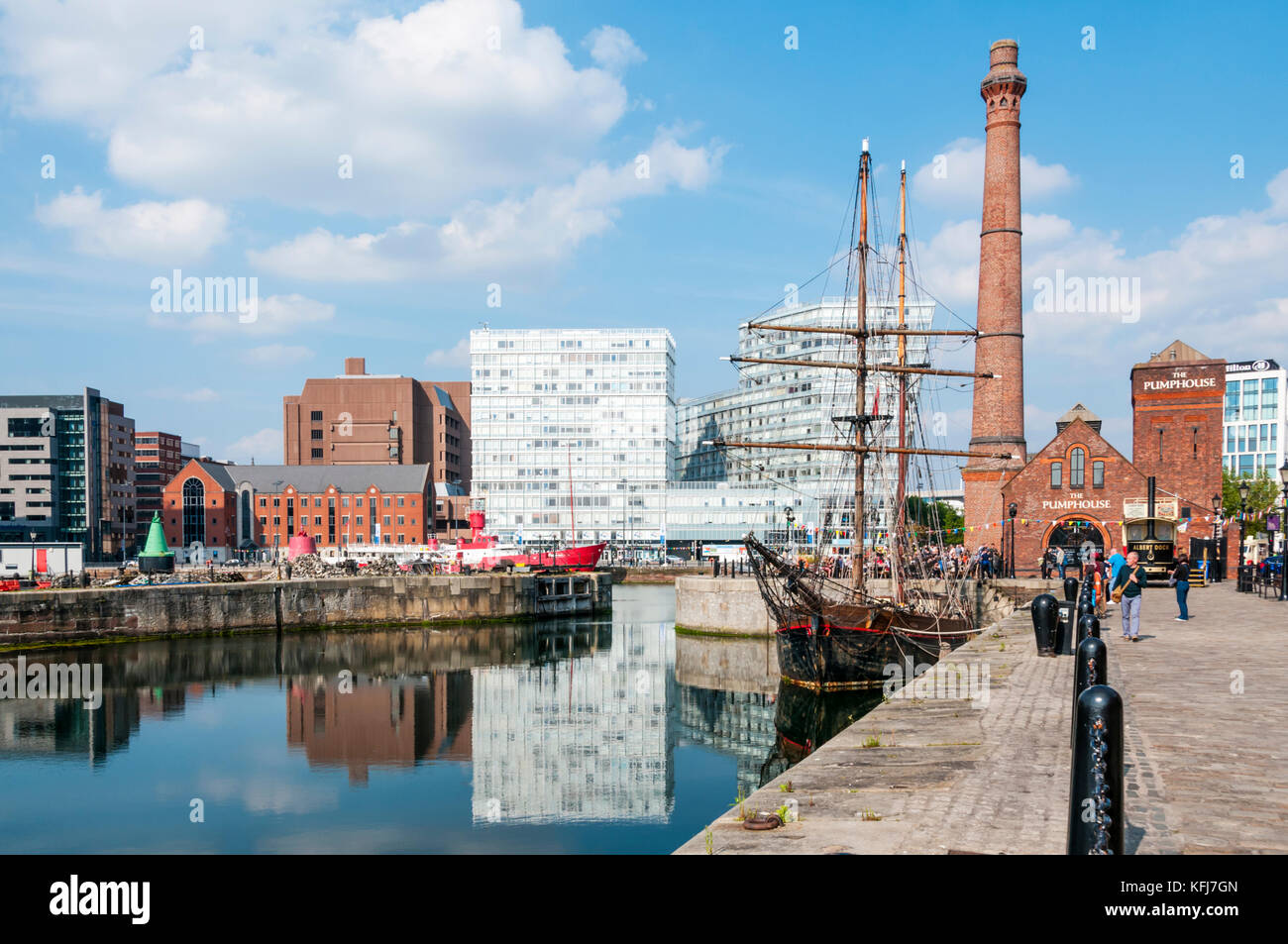 The Canning Dock with restored historic tall ship Zebu and The Pump House public house in Liverpools restored docklands. - Stock Image