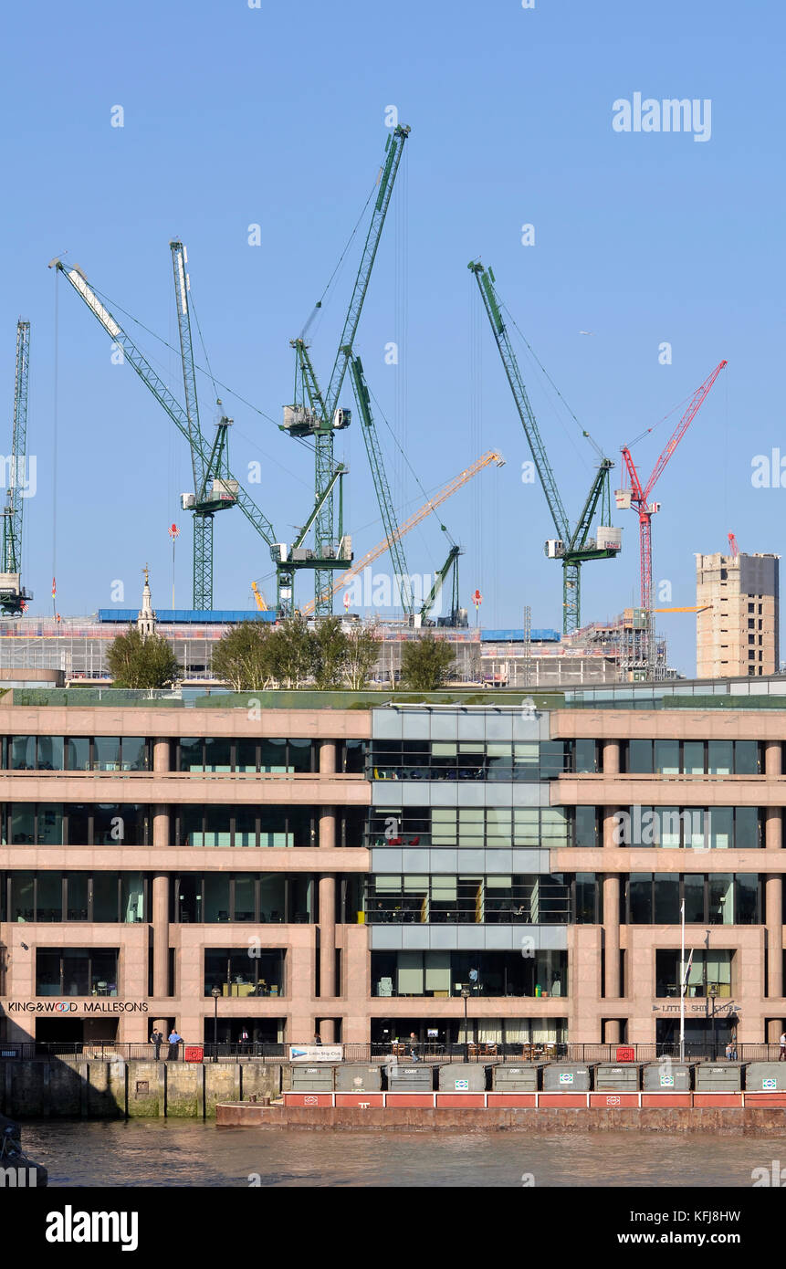 Little Ship Club and King & Wood Mallesons building, London, with Bloomberg Place tower cranes behind. - Stock Image