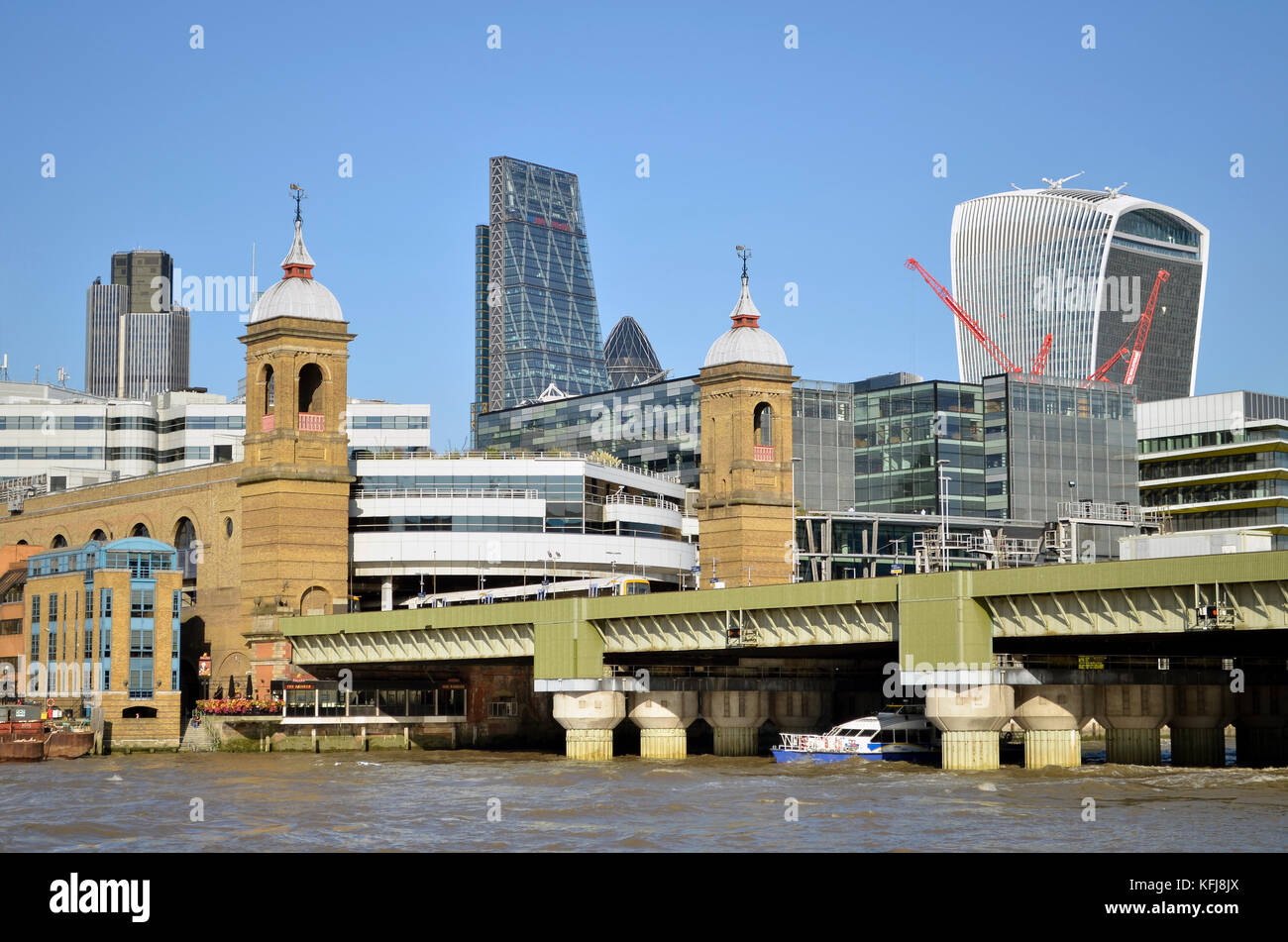 Cannon Street Station and Railway Bridge seen across the River Thames, London, UK. Tower 42, The Leadenhall Building, - Stock Image