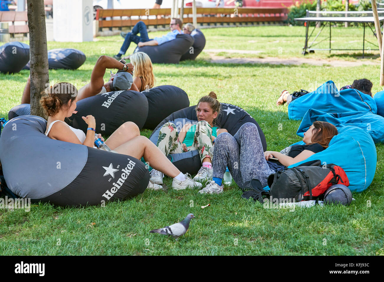 Young people relaxing on bean bags in public park (outdoors) Budapest - Stock Image