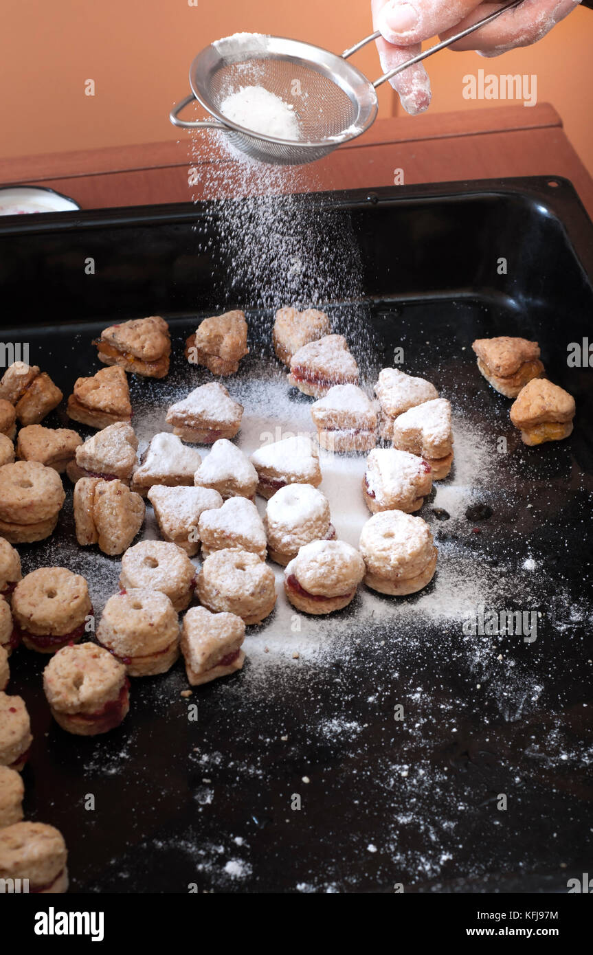close up of female hands making cookies ,candid photography - Stock Image