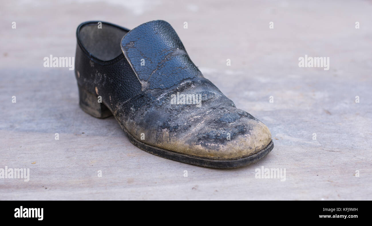 An old worn out man's shoe - Stock Image