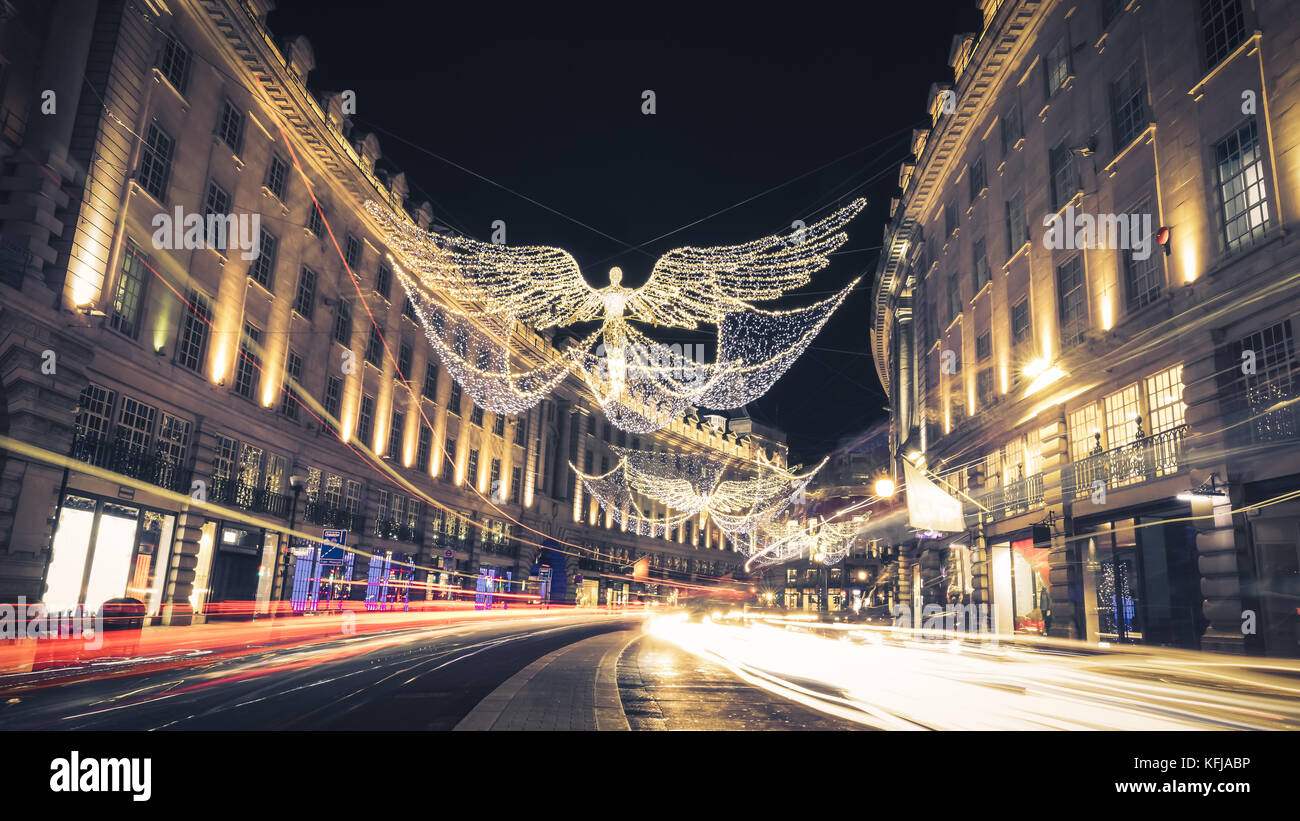 Regent Street Angels Holiday Lights with Car Light Trails in London, United Kingdom - Stock Image