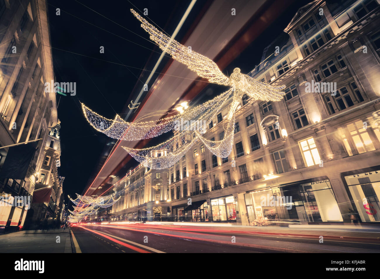 Regent Street Angels Holiday Lights with Double Decker Bus Light Trails in London, United Kingdom - Stock Image