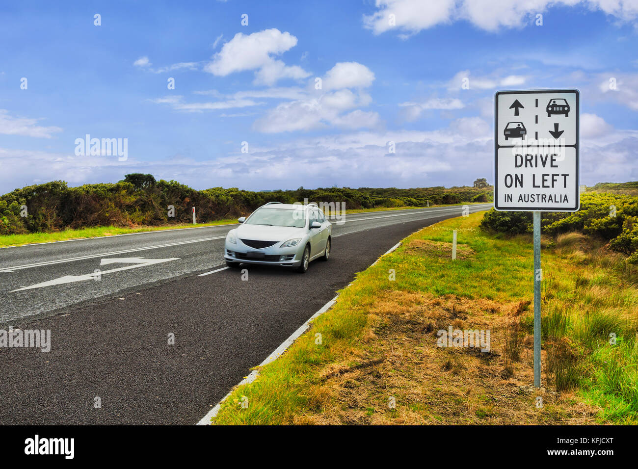 Drive on left in Australia roadside sign on Great Ocean road in VIctoria state next to regional rural speedway with - Stock Image