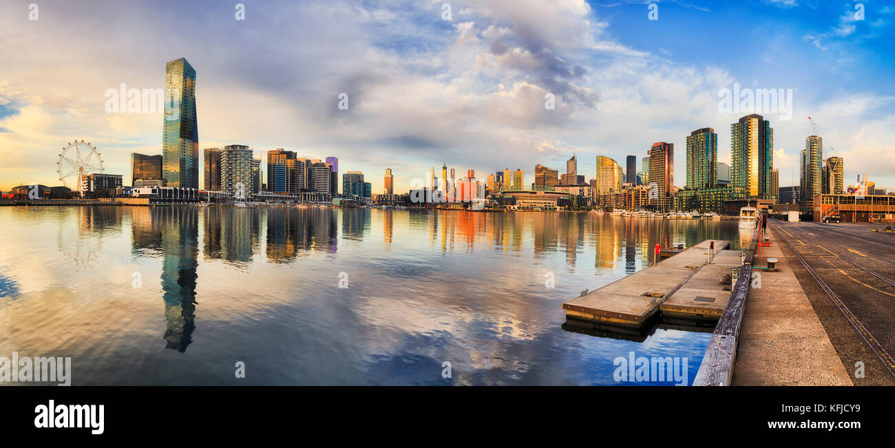 New high-rises of Melbourne in Docklands suburb reflecting in still waters of Yarra river from amusement wheel to - Stock Image